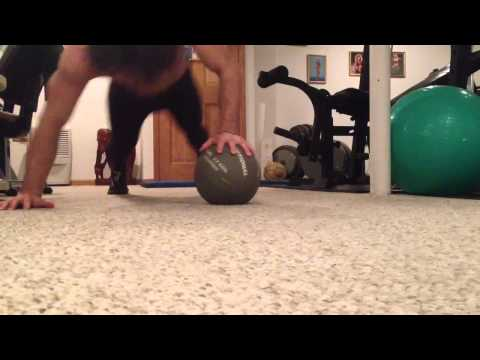 One-arm push-up on medicine ball